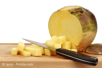 cut turnip(Brassica rapa rapa) with a kitchen knife